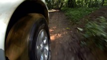 wheel driving on dirt road