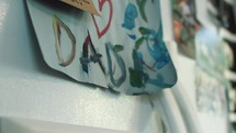 a child's father's day artwork on a refrigerator