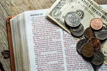 spare change on a Bible