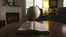 Bible and spinning globe