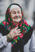 elderly woman wearing a scarf