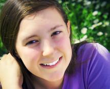 smiling teenage girl outdoors