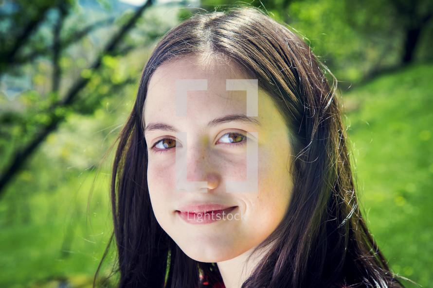 brunette teenage girl outdoors