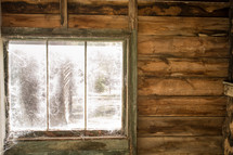 spider webs covering a cabin window