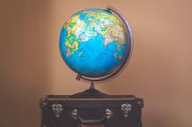 globe on luggage