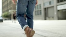 man walking on a sidewalk