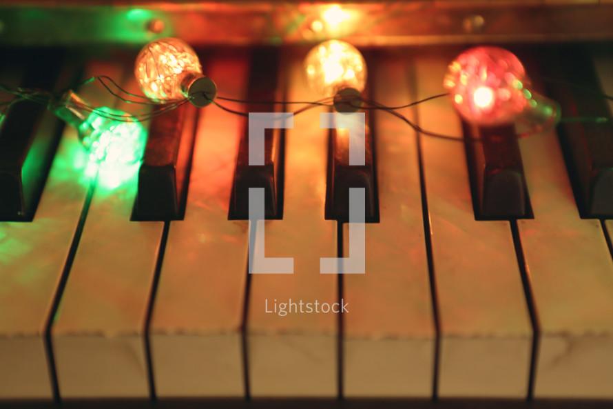 retro coloured lights illuminate a vintage piano