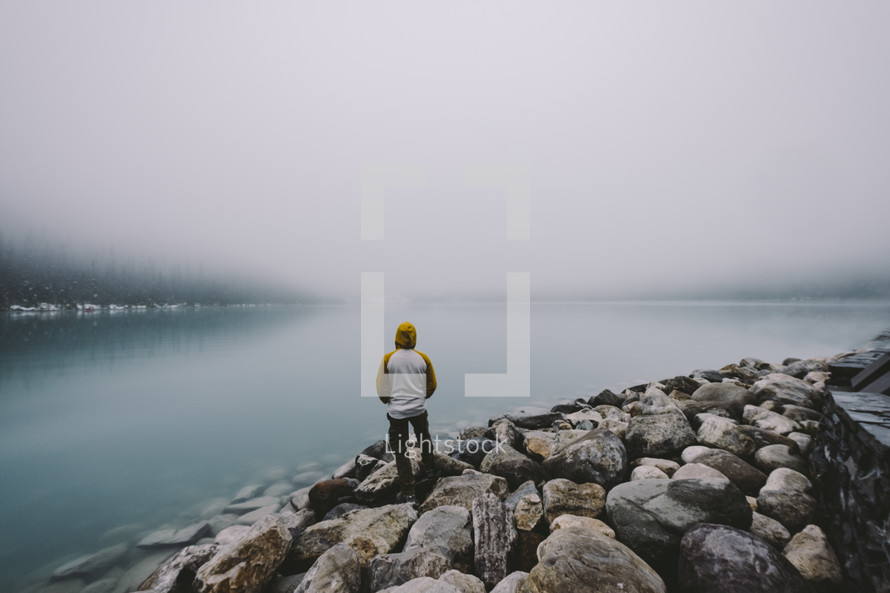 man standing on the shore of Lake Louise