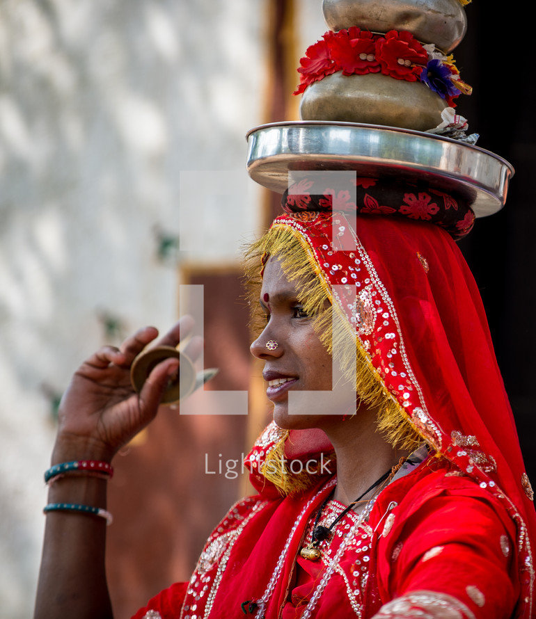 a woman in India balancing items on her head