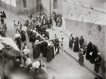 Pilgrims carrying a cross along the Via Dolorosa.