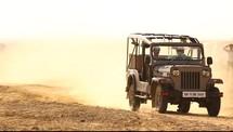 truck driving down a dirt road