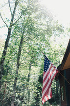 American flag on the side of a cabin
