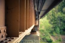 steel beams under a train bridge