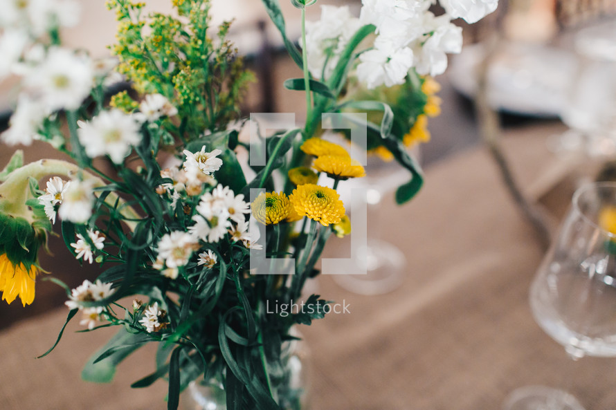 vase of yellow and white flowers