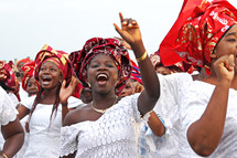African women clapping and dancing in praise and worship to God