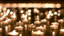 prayer votive candles in darkness