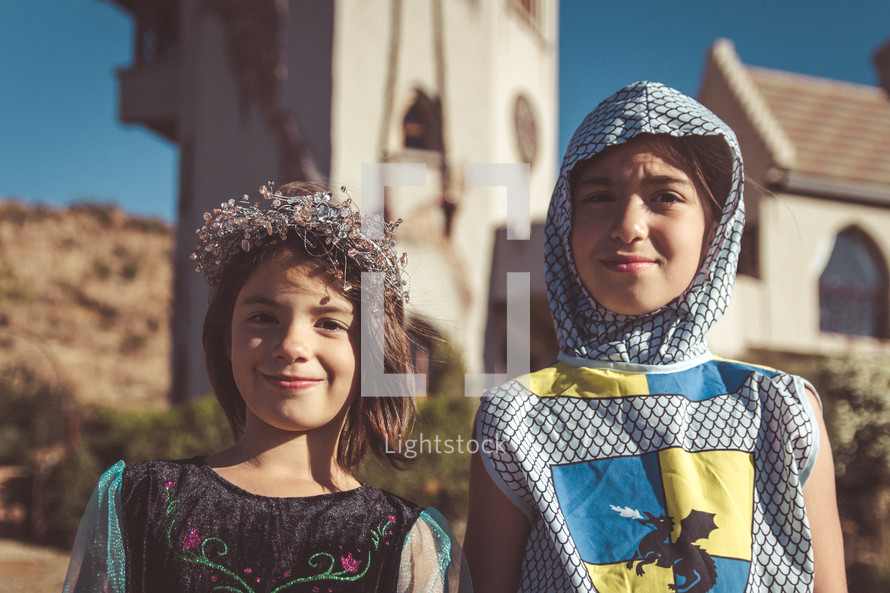 children dressed up like a knight and princess