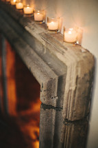 votive candles at the top of a doorway