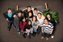 group of young people of different ethic groups taken from above the group