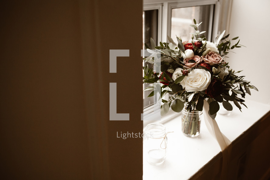 flower arrangement in a window