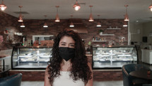 a female in a cafe wearing a face mask