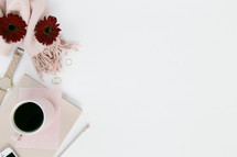 stationary, pencil, watch, iPhone, red gerber daisies, white background, nail polish, pink scarf, gold rings, pencil