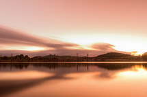 sunrise over a lake and reflection of sunlight on the water