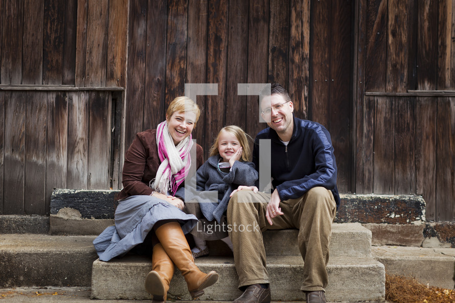 family sitting on stair steps