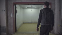 a man entering a warehouse elevator
