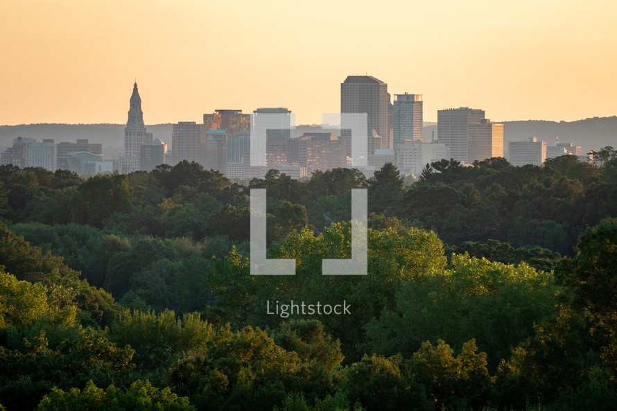 City of Hartford Connecticut skyline and trees at golden hour