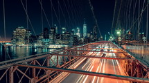 traffic on Brooklyn Bridge at night