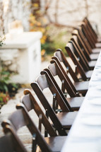 wood folding chairs at a wedding reception