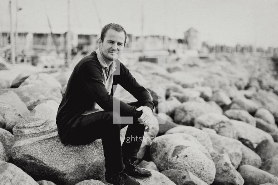 man sitting on rocks outdoors