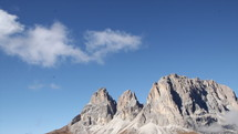 clouds wisping over dlolomite mountains in Italy