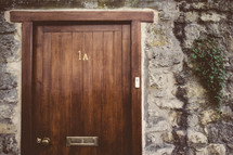 wood door with mail slot