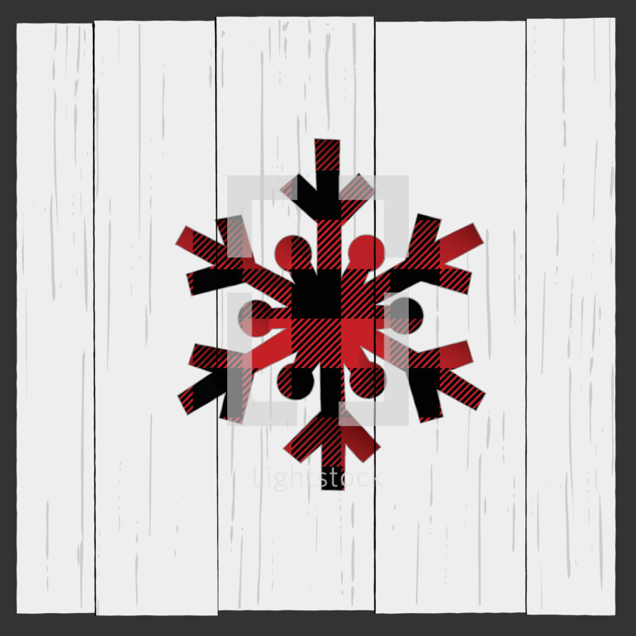 Plaid red snowflake Christmas decoration on farmhouse wood