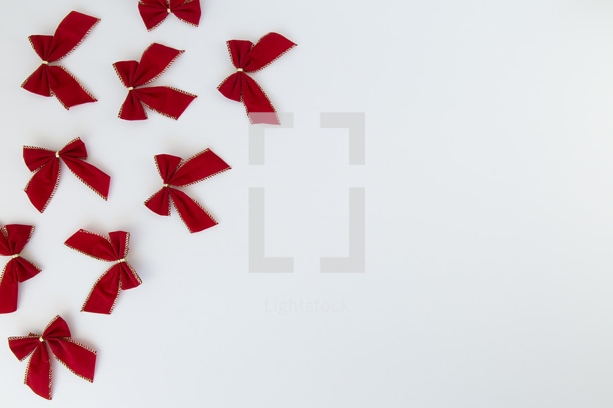 red and gold bows on white