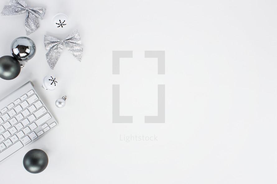 computer keyboard and holiday ornaments
