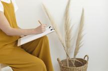 a female holding a clipboard