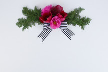 flower and pine with bow on white background