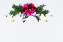flowers and pine with striped bow and Christmas bells