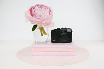 pink peony, books, and camera