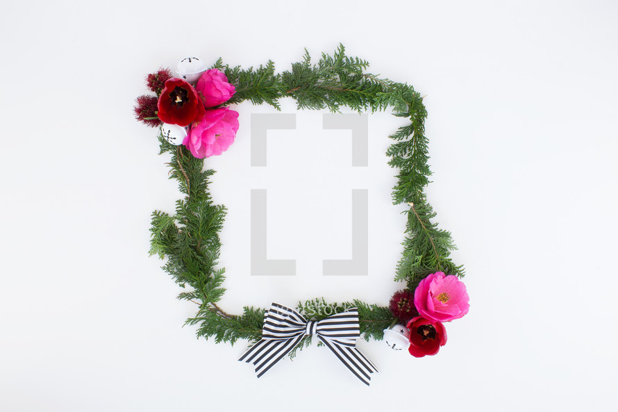 frame of pine and flowers and Christmas bells