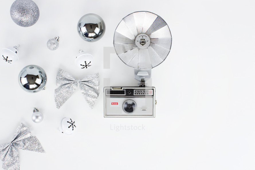 vintage flash camera and holiday decorations