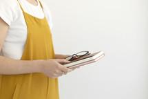 female holding notebooks