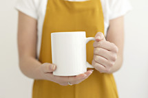 female holding a coffee mug