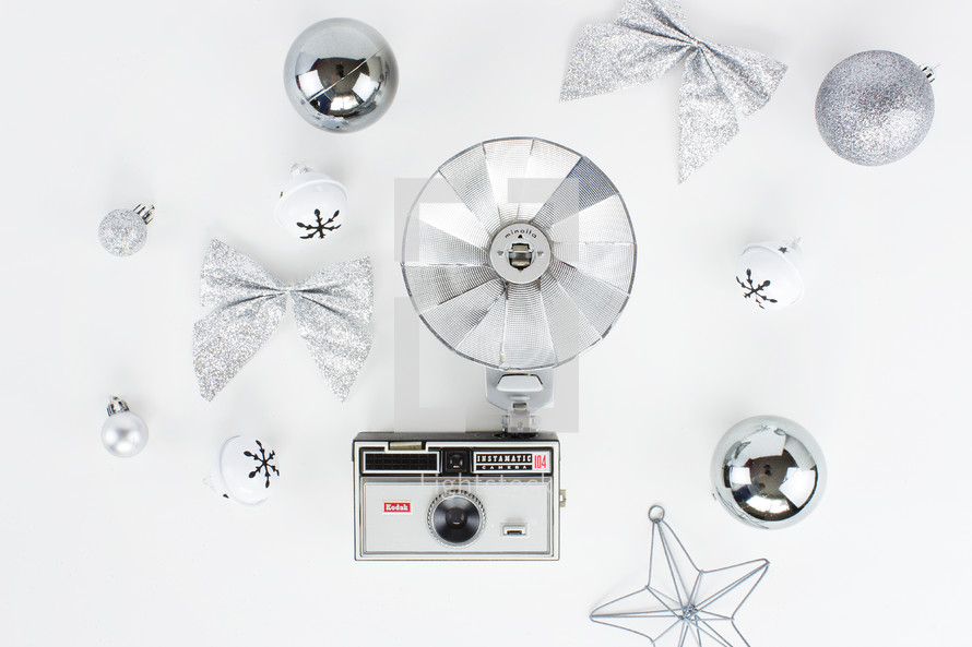 vintage camera and silver Christmas decorations