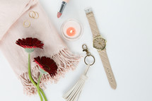 gerber daisies, watch, keychain, pink, red, rings, gold, jewelry, white background, feminine, lipstick, scarf