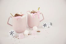 pink mugs and Christmas bells