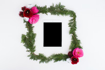 pine and flower frame around an iPad